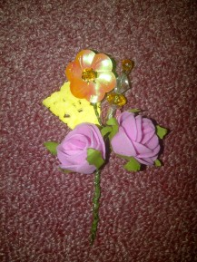 DIY boutonnieres for the wedding.