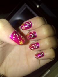 DIY nail art with dotting tools.