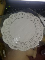 Experimenting with doilies for the wedding.