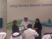 Mom receiving her 15th year certificate from RG. (Dec.'12)